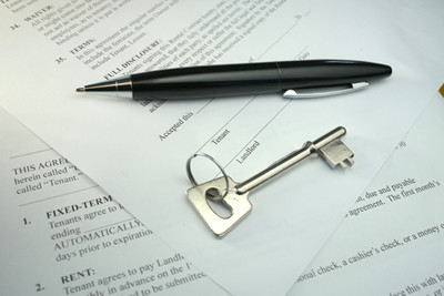 image pen and key lying on lease