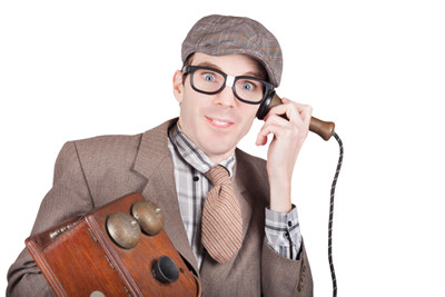 Image man holds old style phone