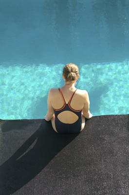 image girl sits on the edge of a pool