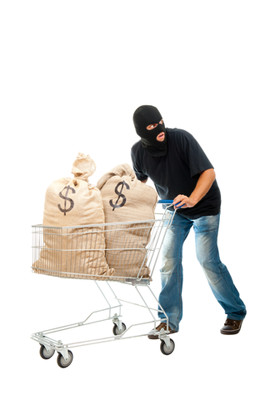 Shoplifting - a thief with a shopping cart full of money