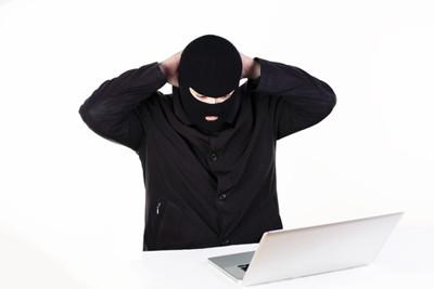 image hacker caught at laptop