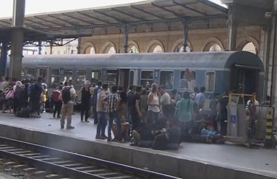 group of refugees on a train platform