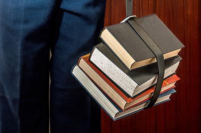 High school graduate with books