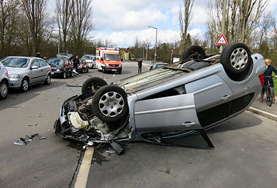An unaware dog makes a car flip over; note: it's a stock photo