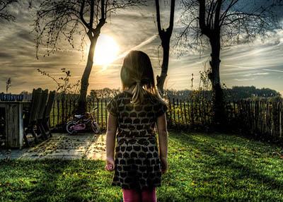 image girl looks over backyard