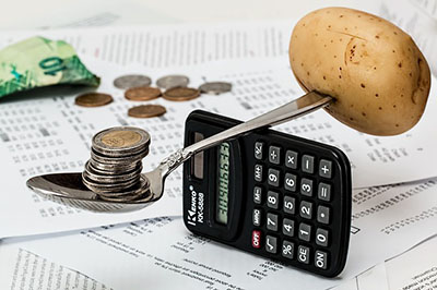 Coin and potato balance on a calculator