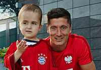 Polish boy with most of brain removed recovers after 5 years, meets football idol