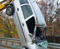 Car flips over and lands vertically – drunk driver gets out singing, wearing only underwear