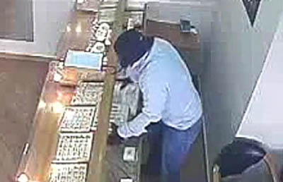 thief at a jeweller shop